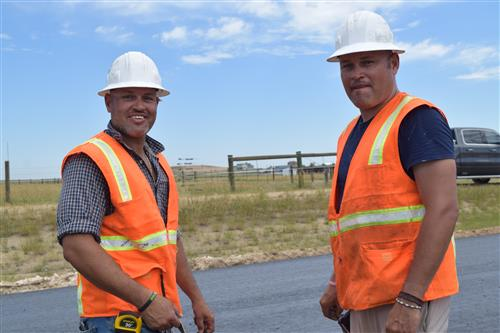 Victor Hernandez and his brother Juan Hernandez own the company striping 136th Avenue.