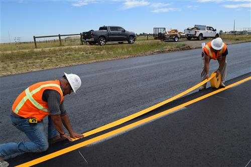 Putting down the stripes for 136th Avenue was started on July 16.