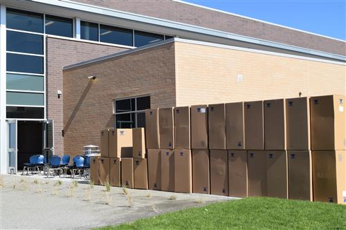 Boxes of furniture are being moved into the new middle school.