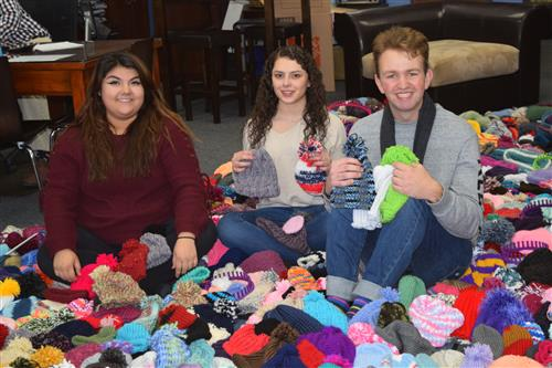Brighton High students donate beanies for kids with leukemia