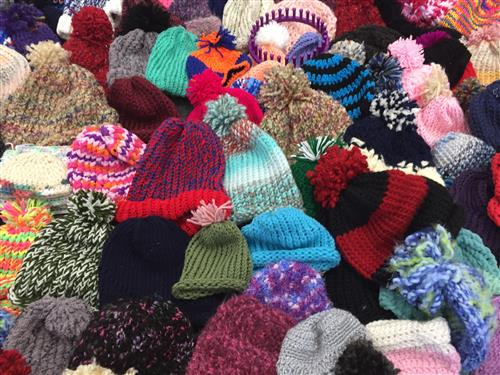 A close up photo of the handmade beanie hats.
