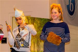 student actors in costume as the cowardly lion and the tin man