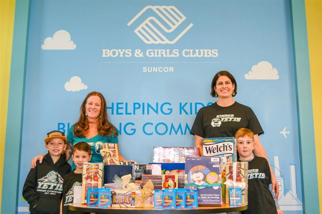 Reunion PTO makes donation to Suncor Boys & Girls Club