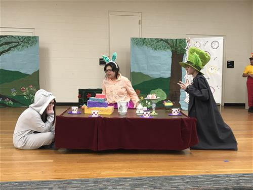 Having a tea party in Alice In Wonderland