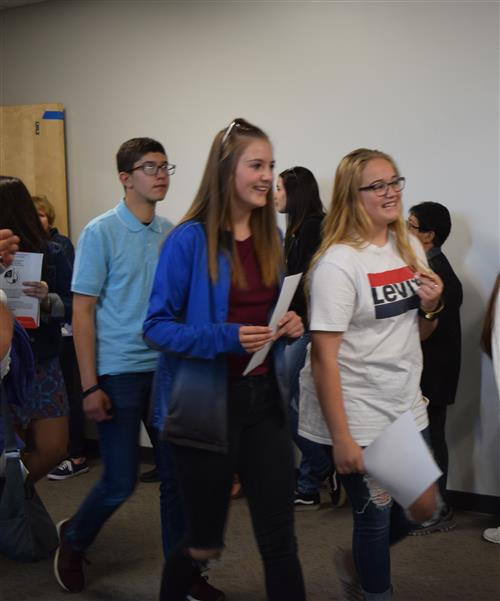 Quist 8th graders walk through the building on their last day of middle school.
