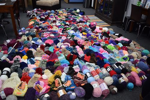 Crocheted hats and donated yarn took up most of the floor space at Rippy Insurance office