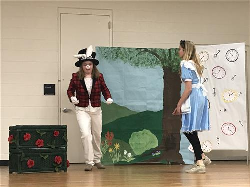 Alice meets the White Rabbit.