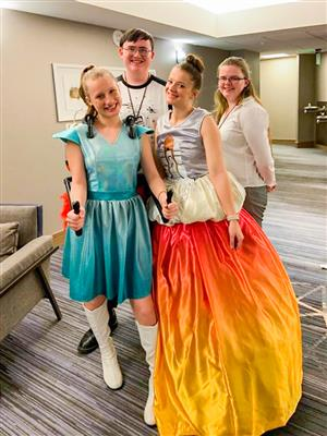 students pose after fashion design competition