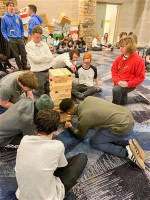 students compete in a giant jenga competition