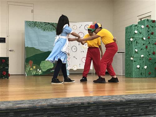 Alice dancing with friends