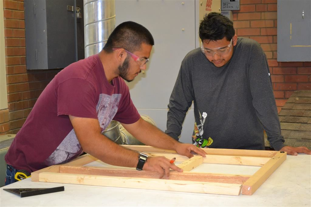 Male students doing wood shop